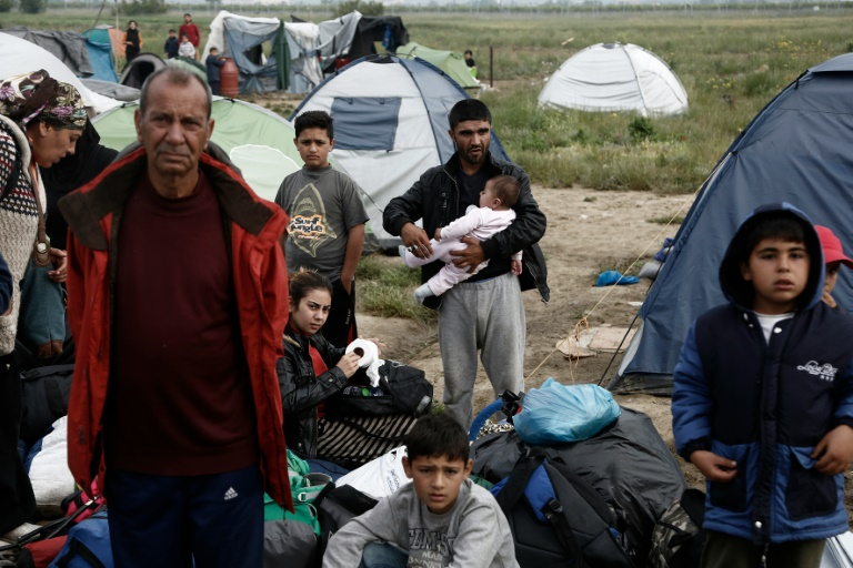 Pool/AFP / Yannis Kolesidis<br />Greek authorities predict it will take 10 days to clear all the 8,400 refugees and migrants from a makeshift camp on the Greek-Macedonian border near Idomeni, on May 24, 2016