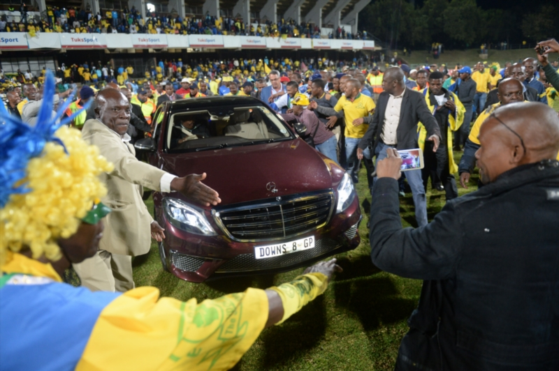 Sundowns owner Patrice Motsepe celebrates with fans during the Absa Premiership match between University of Pretoria and Mamelodi Sundowns at Tuks Stadium on May 04, 2016 in Pretoria, South Africa. (Photo by Lefty Shivambu/Gallo Images)