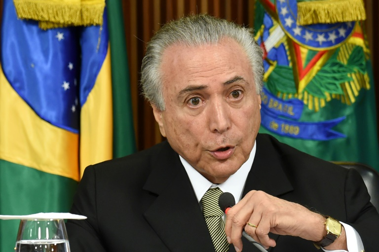 AFP / Evaristo Sa<br />Acting Brazilian President Michel Temer presents his economic measures during a meeting with the leaders of allied parties in Congress at the Planalto Palace in Brasilia on May 24, 2016