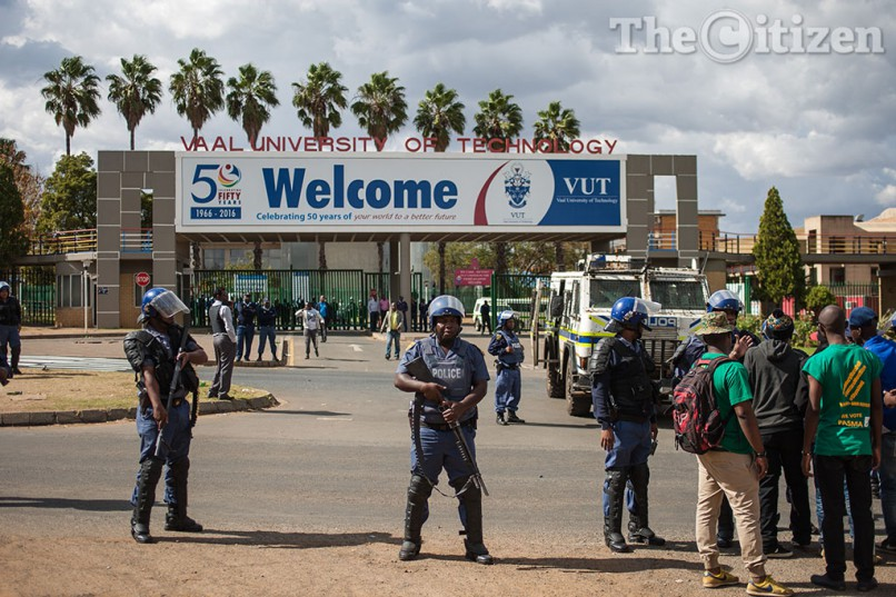 Police gather outside the entrance to the VUT campus where security is preventing protesters from entering the premises on 11 May 2016. Students were protesting against the security company contracted to protect the campus. PHOTO: Jacques Nelles