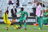 Stephen Keshi, coach of Nigeria looks on as Danny Phiri of Zimbabwe tackles Christantus Ejike of Nigeria   during the 2014 CAF African Nations Championships 3rd/4th playoff between Zimbabwe and Nigeria at Cape Town Stadium, Cape Town on 1 February 2014 ©Gavin Barker/BackpagePix
