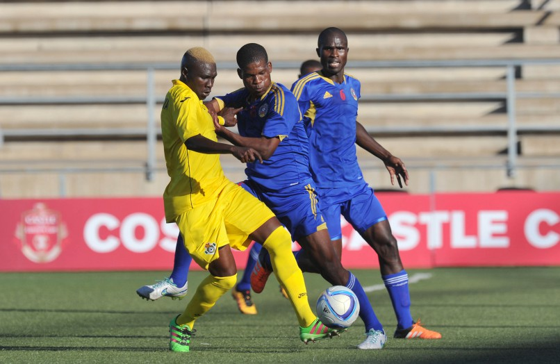 Njabulo Ndlovu of Swaziland challenges Obidiah Tarumbwa of Zimbabwe during the 2016 Cosafa Cup match between Zimbabwe and Swaziland at Sam Nujoma Stadium in Windhoek, Namibia on June 11. Photo: ©Muzi Ntombela/BackpagePix