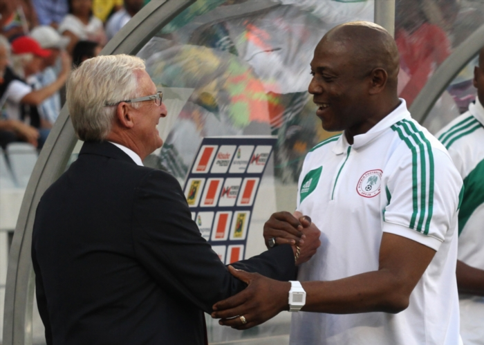 South African coach Gordon Igesund and Nigerian coach Stephen Keshi meet before the kick off during the 2014 African Nations Championship match between South Africa and Nigeria at Cape Town Stadium on January 19, 2014 in Cape Town, South Africa. (Photo by Shaun Roy/Gallo Images)