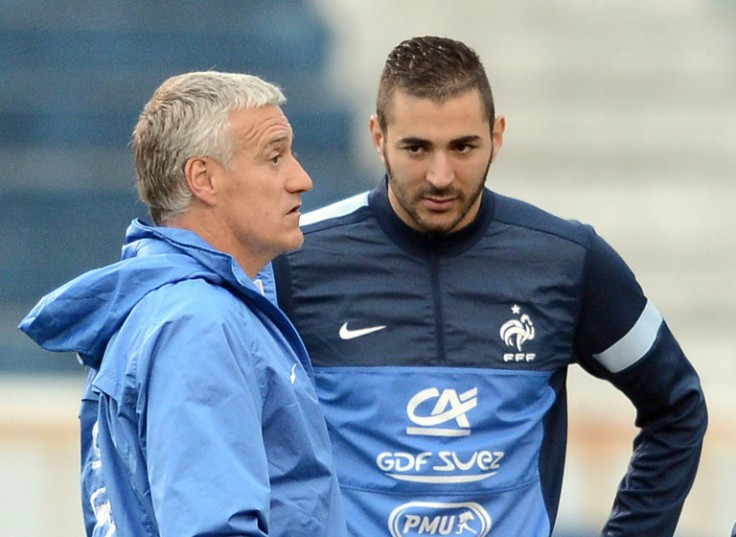 """AFP/File / Franck Fife <br />Karim Benzema (R) claimed """"a racist part of France"""" was to blame for his exclusion from the French side, coached by Didier Deschamps (L)"""