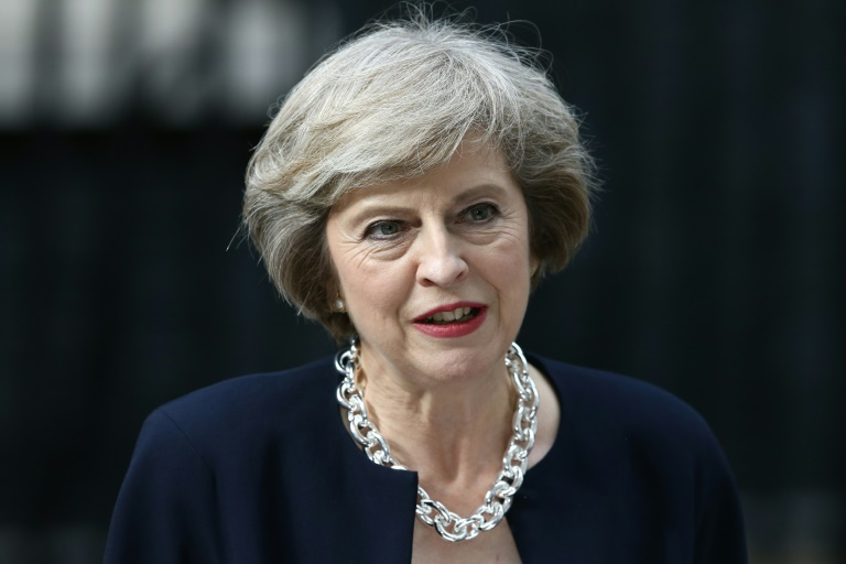 """AFP/File / Justin Tallis<br />British Prime Minister Theresa May noted in a phone call to EU Council president Donald Tusk that her government will be """"very busy with negotiations to leave the EU"""" in 2017"""