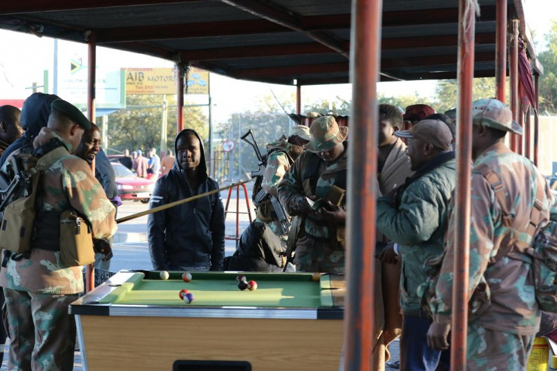 Soldiers searching a group of man at Beitbridge border post.  Photo:Chester Makana/ANA