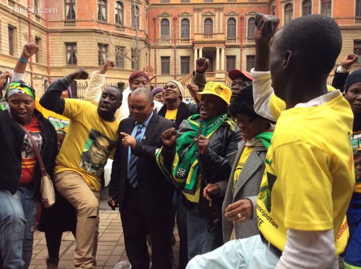 Soshanguve ward councillor Lucas Ngobeni (in suit) celebrates his court victory with members of his community. Picture: Ilse de Lange