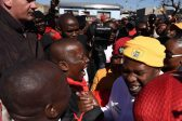 Malema shakes hands with ANC's Masina, Maile