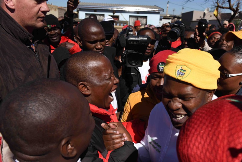 Malema shaking hands with the ANC's Lebogang Maile in July. Picture: Neil McCartney