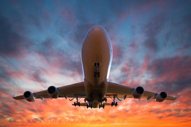 Illustration of airplane taking off at sunset. Photo: Corbis