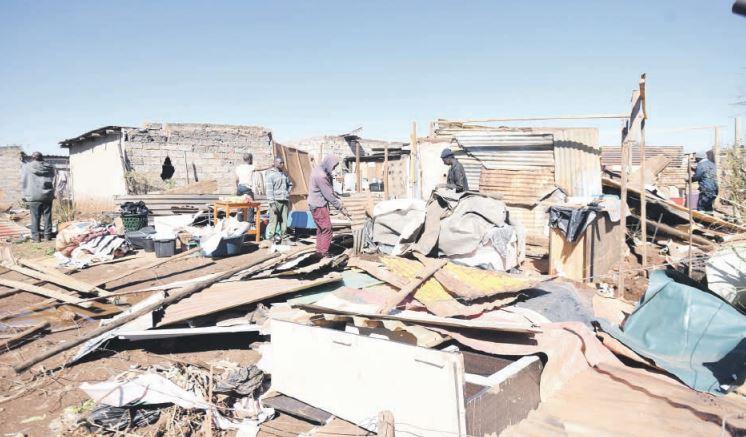 Tembisa residents rebuild their shacks after a tornado caused massive damage. Pictures: Nigel Sibanda