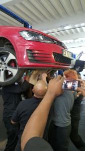 Mechanics work together to safely remove the vervet monkey. Photo: Zululand Observer