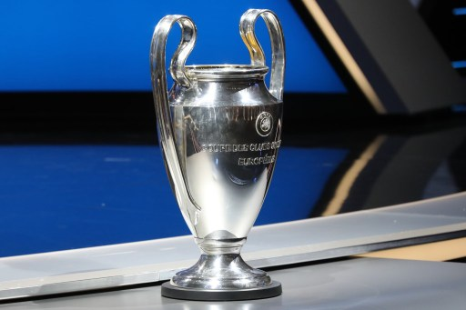 The Champions League trophy is pictured at the start of the UEFA Champions League Group stage draw ceremony, in Monaco.  AFP PHOTO / VALERY HACHE / AFP PHOTO / VALERY HACHE