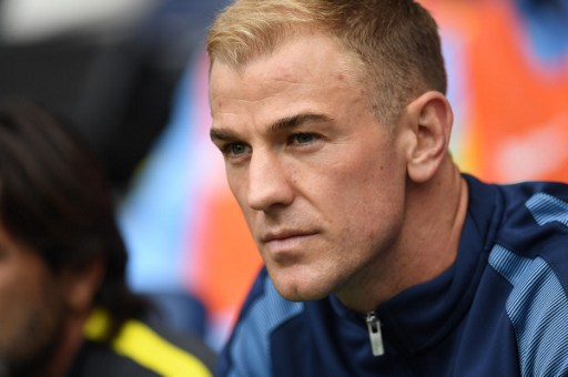 Manchester City's English goalkeeper Joe Hart sits on the substitutes bench for the English Premier League football match between Manchester City and Sunderland at the Etihad Stadium in Manchester, north west England, on August 13, 2016. Manchester City manager Pep Guardiola dropped goalkeeper Joe Hart in favour of Willy Caballero for his opening Premier League game against Sunderland on August 13. / AFP PHOTO / PAUL ELLIS / RESTRICTED TO EDITORIAL USE. No use with unauthorized audio, video, data, fixture lists, club/league logos or 'live' services. Online in-match use limited to 75 images, no video emulation. No use in betting, games or single club/league/player publications.  /