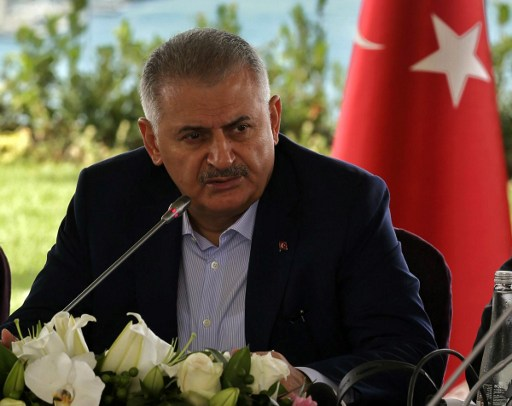 """This handout photo taken and released on August 20, 2016 by the Turkish Prime Minister Press Office shows Turkey's Prime Minister Binali Yildirim speaking during a meeting with foreign media representatives in Istanbul. / AFP PHOTO / TURKISH PRIME MINISTRE PRESS OFFICE / HAKAN GOKTEPE / RESTRICTED TO EDITORIAL USE - MANDATORY CREDIT """"AFP PHOTO / TURKISH PRIME MINISTER OFFICE/ HAKAN GOKTEPE """" - NO MARKETING - NO ADVERTISING CAMPAIGNS - DISTRIBUTED AS A SERVICE TO CLIENTS"""