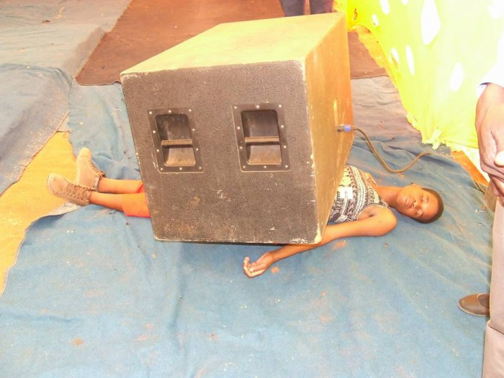 A speaker is placed on the woman's abdomen. Picture:  Lethebo Rabalago on Facebook