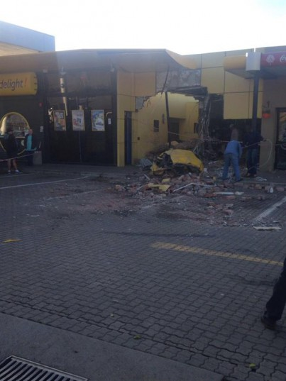 The truck crashed through the barrier and into three other vehicles at the garage before coming to a stop in the restaurant. Photos: Lyndall Mgadle