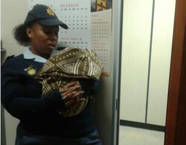 Constable Thembisa Dlamini is seen with the baby who was abandoned last week. Picture: Berea Mail.
