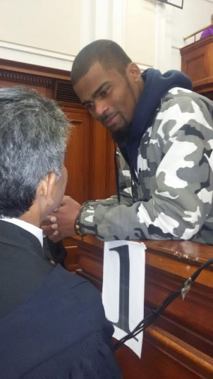 Aljar Swartz chats to his defence lawyer before being sentenced. Photo: Catherine Rice / ANA