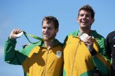 RIO DE JANEIRO, BRAZIL - AUGUST 11:  Lawrence Brittain of South Africa and Shaun Keeling of South Africa celebrate winning the silver medal in the Men's Pair Final A on Day 6 of the Rio 2016 Olympic Games at the Lagoa Stadium on August 11, 2016 in Rio de Janeiro, Brazil.  (Photo by Matthias Hangst/Getty Images)