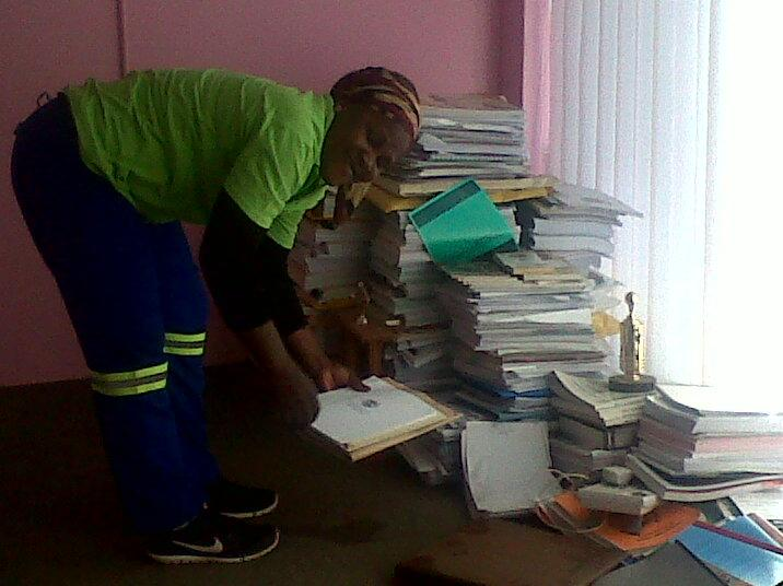 Municipal workers in Thabazimbi arranging files after furniture was taken for nonpayment of service providers.