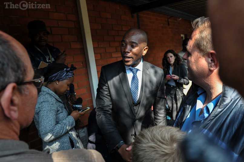 Mmusi Maimane speaks to voters at Capital Park Primary School voting station on August 3, 2016, in Pretoria. Picture: Jacques Nelles