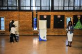 Solly Msimanga showing his son how to vote at Capital Park Primary School voting station, 3 August 2016, Pretoria. Picture: Jacques Nelles