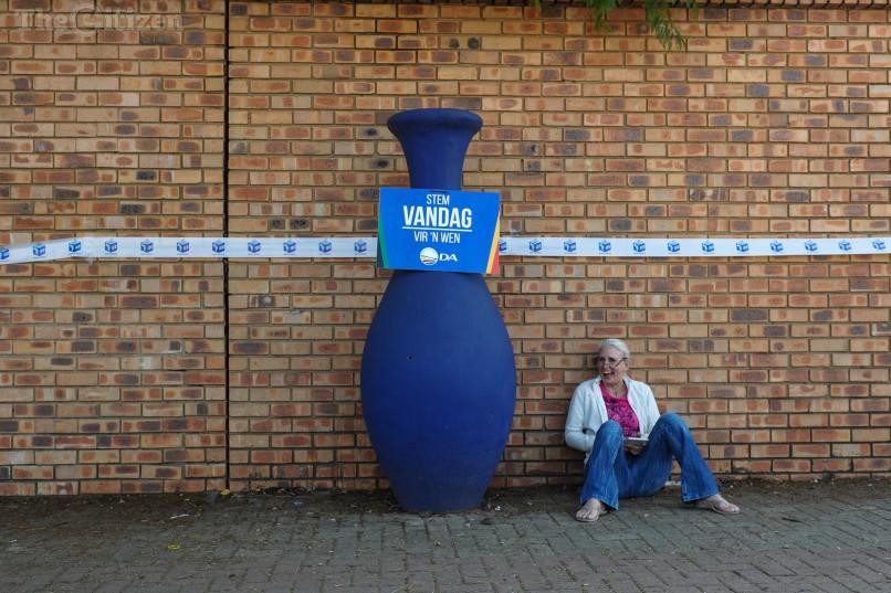 A lady rests outside Capital Park Primary School voting station, 3 August 2016, Pretoria. Picture: Jacques Nelles