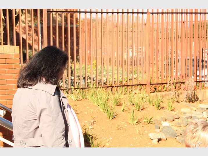 Vicki Momberg hangs her head as she walks out of the Randburg Magistrates' Court.