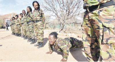 GIVE ME 10! Black Mambas member Nocry Mzimba does press-ups yesterday during a parade for South Africa's top female anti-poaching unit. Picture: Nigel Sibanda
