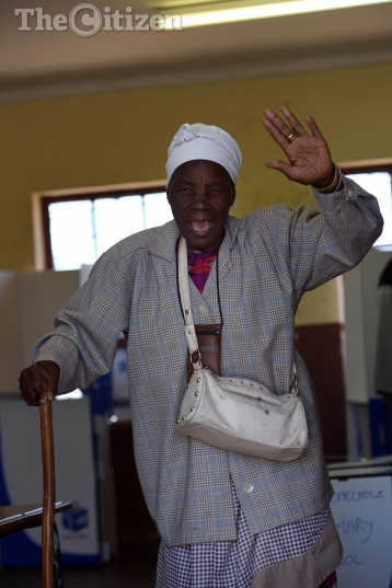 Seshego resident Felepina Mphama celebrates after casting her vote at Mponegele Primary School in  Polokwane, 3 August 2016, during the Local government elections. Picture: Nigel Sibanda