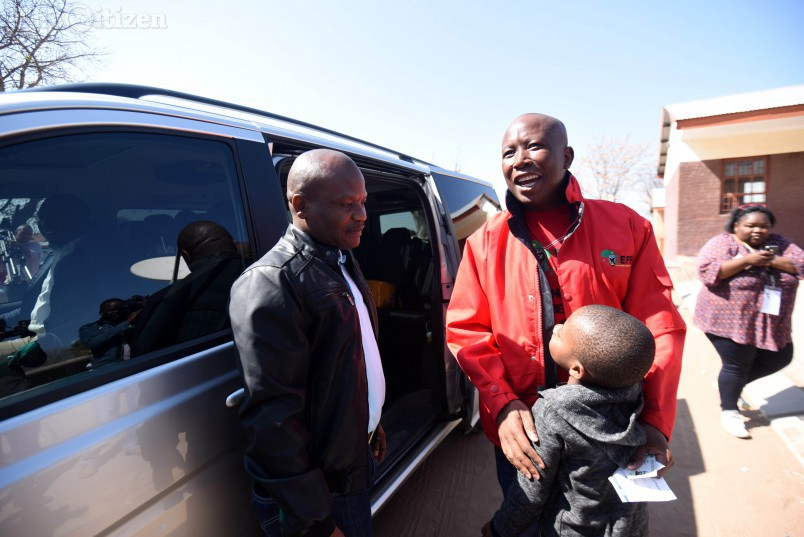 EFF Leader Julius Malema after casting his vote jokes with Karabo (8) at Mponegele Primary School in Polokwane, 3 August 2016, during the local government elections. Picture: Nigel Sibanda