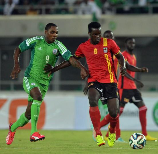 Igalo Jude of Nigeria challenges Aucho Khalid (R) of Uganda during the International friendly match between Nigeria and Uganda at Akwa Ibom Stadium. (Kabiru Abubakar/Backpagepix)