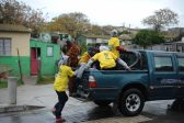 Children hitch a ride passed a voting station , 3 August 2016, in Helenvale, in Nelson Mandela bay, Port Elizabeth, during the local government elections. Picture: Alaister Russell