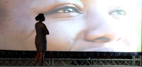 Josephine Mbire as she watches her projection in The Perfect Life
