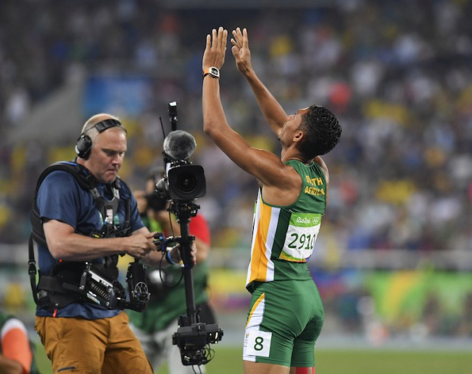 RIO DE JANEIRO, BRAZIL - AUGUST 14: Wayde van Niekerk of South Africa raises his hands in praise after winning the mens 400m final and set a new world record of 43.03 seconds during the evening session on Day 9 Athletics of the 2016 Rio Olympics at Olympic Stadium on August 14, 2016 in Rio de Janeiro, Brazil. (Photo by Roger Sedres/Gallo Images)