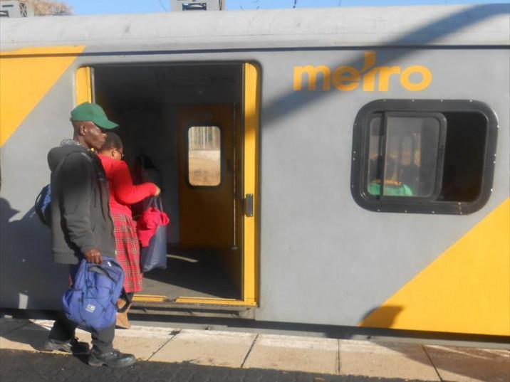 Mkhulu Jeff Radebe (63) boards a train to Soshanguve.
