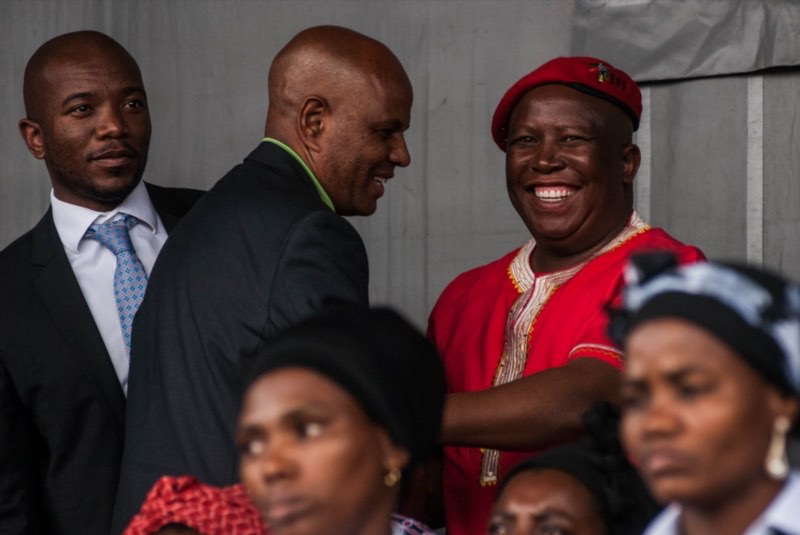 Mmusi Maimane, Joseph Mathunjwa and Julius Malema during the commemoration rally of the second anniversary of the Marikana massacre on August 16, 2014 in Rustenburg. Picture: Gallo Images