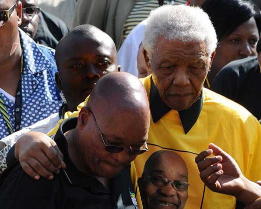 Then presidential favourite Jacob Zuma (L) helps former South African president Nelson Mandela at the end of an African National Congress (ANC) election rally in Johannesburg on April 19, 2009. Picture: AFP