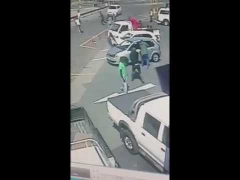 Durban's parking lot victim fighting for his life.