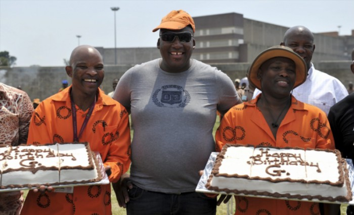 Controversial businessman Gayton McKenzie poses with his birthday cakes held by two inmates at Johannesburg Central Prison in Johannesburg, South Africa on 10 March 2011 where he and business partner Kenny Kunene held a party to celebrate McKenzie's birthday. Picture: Gallo Images