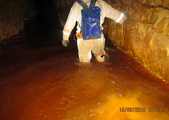 Mine Rescuer negotiates flooded shaft.
