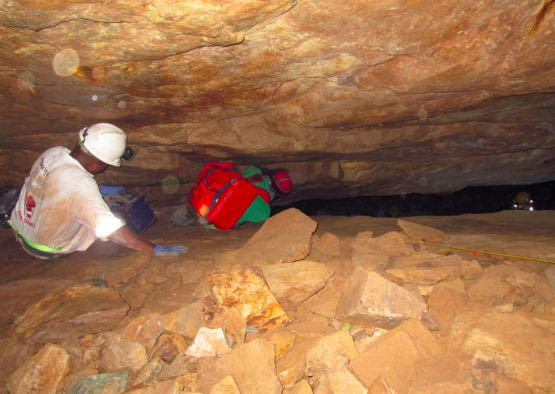 Mine Rescuer follows illegal miner down shaft to assist in recovering body of colleague.