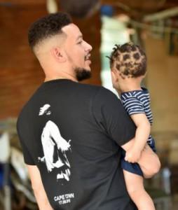 AKA and his daughter Kairo. Image by Nigel Sibanda.
