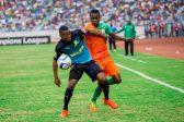 Themba Zwane of Mamelodi Sundowns shields the ball from Zesco United midfielder John Chin'gandu