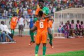 Jackson Jesse Were and Simon Silwimba celebrate after Zesco United score their second goal through Jackson Mwanza