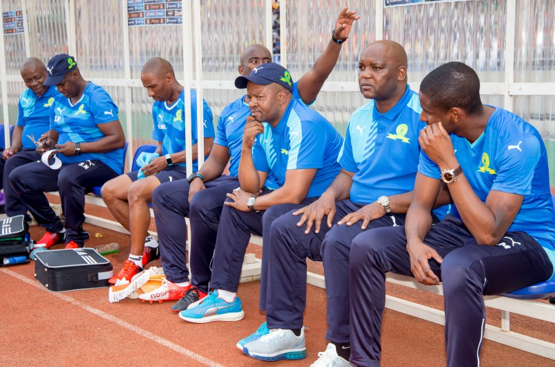 Pitso Mosimane of Mamelodi Sundowns (second from right) on the bench during the game between Zesco United and Sundowns  at Levy Mwanawasa Stadium