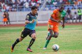 Keagan Dolly of Mamelodi Sundowns dribbles past Misheck Chaila of Zesco United
