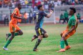 Zesco United's Misheck Chaila and Adama Ben Bahn beaten to the ball by Keagan Dolly of Mamelodi Sundowns