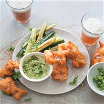 Beer-battered fish goujons with fried baby marrows and pesto-sour-cream sauce. Picture: Food and Home
